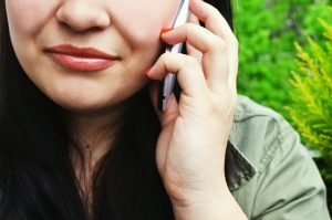 person woman smartphone calling