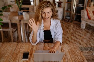 young woman with laptop on video call